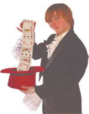 A boy pulls cards out of a top hat.