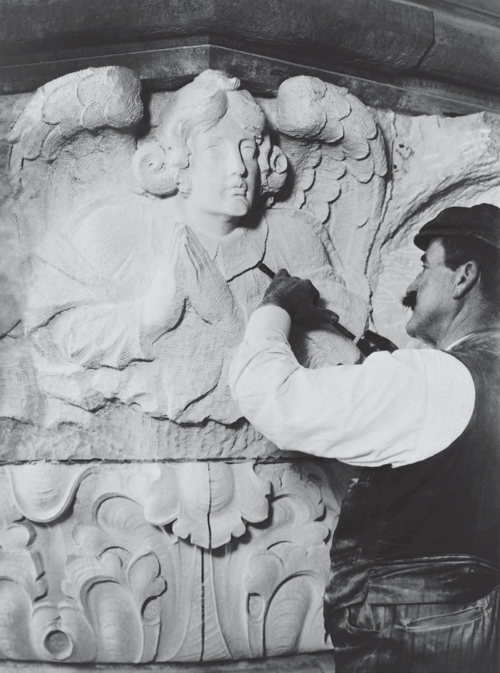 Sculptor Carving Stone
