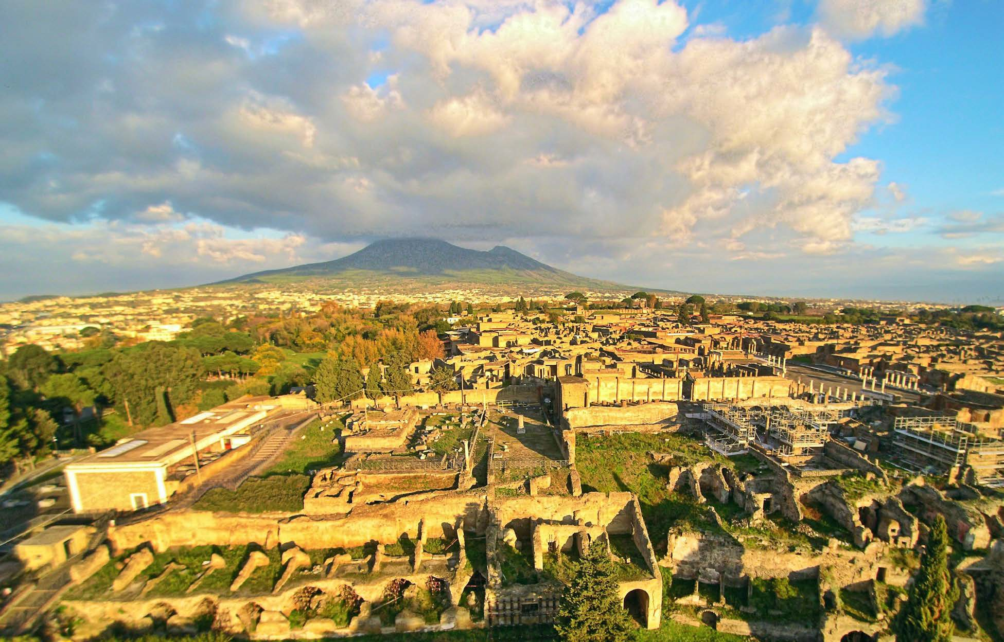 Ruins of Pompeii from above, with Vesuvius in the background