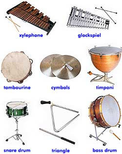 percussion instruments. a xylophone, a glockspiel, a tambourine, a set of cymbals, a timpani, a snare drum, a triangle, a bass drum