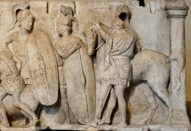 Two Roman Infantrymen and a Cavalryman, second century BCE carved into stone.